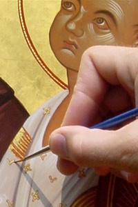 Applying finishing touches. Icon painting by John Snogren.